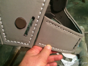 Closeup of back/strap joint. Note slots for securing strap.