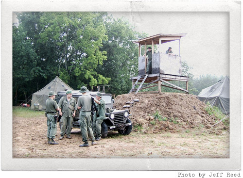 Troops, jeep, and the firebase tower